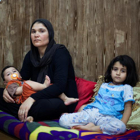 An Iraqi mother with her two children