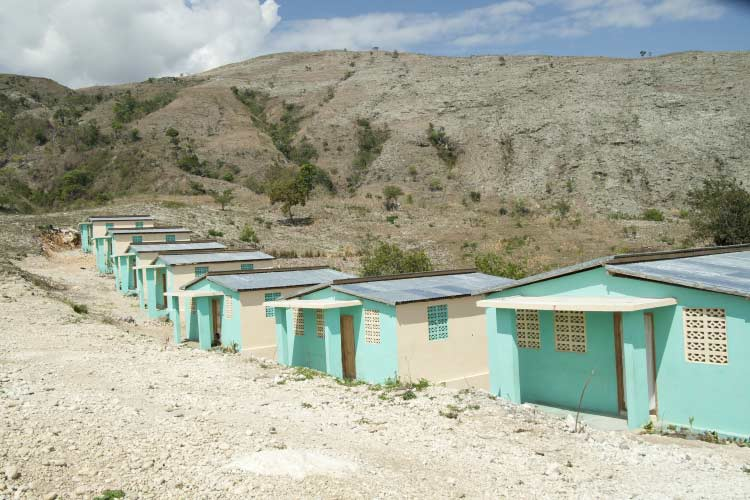 A row of turquoise-coloured homes in Haiti