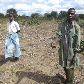 Fatima and Elias Baela in a field in Malawi