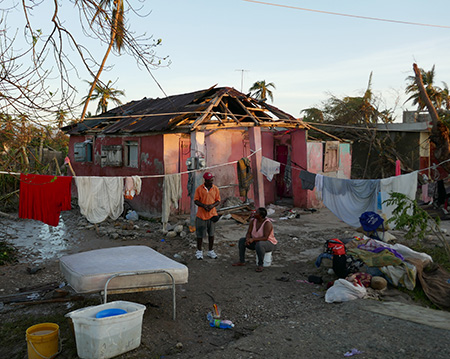 Viola sits in front of her house in south Haiti