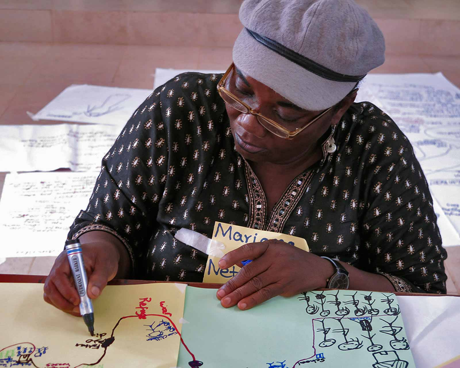 Mariama, part of the Kailahun Women in Governance Network, draws her life map