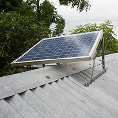 A solar panel on top of a roof in Bangladesh