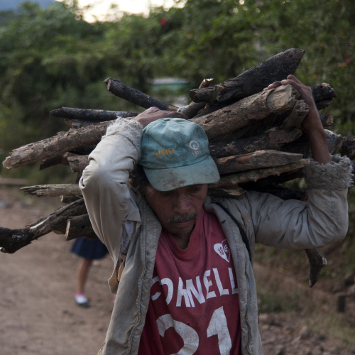 A man carrying wood in El Salvador