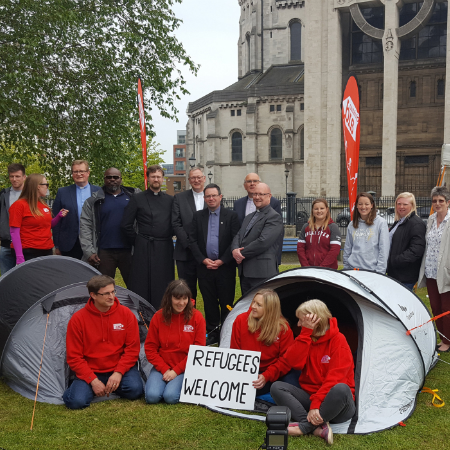A group of Christian Aid supporters camping outside of the Houses of Parliament in support of refugees