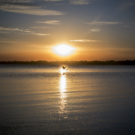 Sun setting over the water at Laguna Isiboro in San Ignacio de Moxos