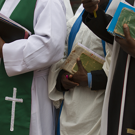 Clergy in Kenya holding books