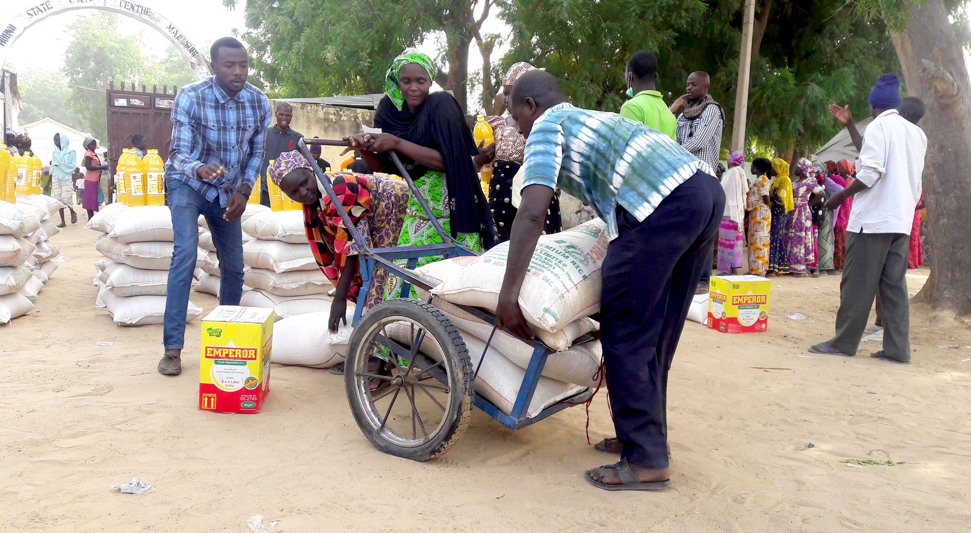 Christian Aid volunteers help to load a truck of supplies for internally displaced people in Nigeria