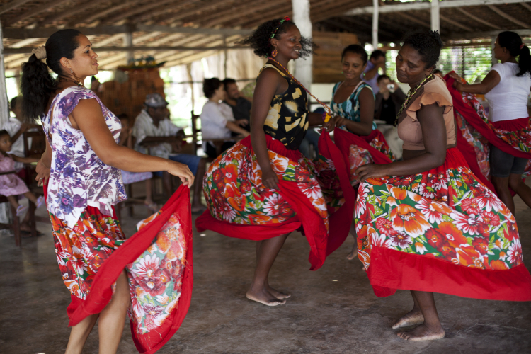Women dancing from the Arapapuzinho Quilombola community in Brazil.