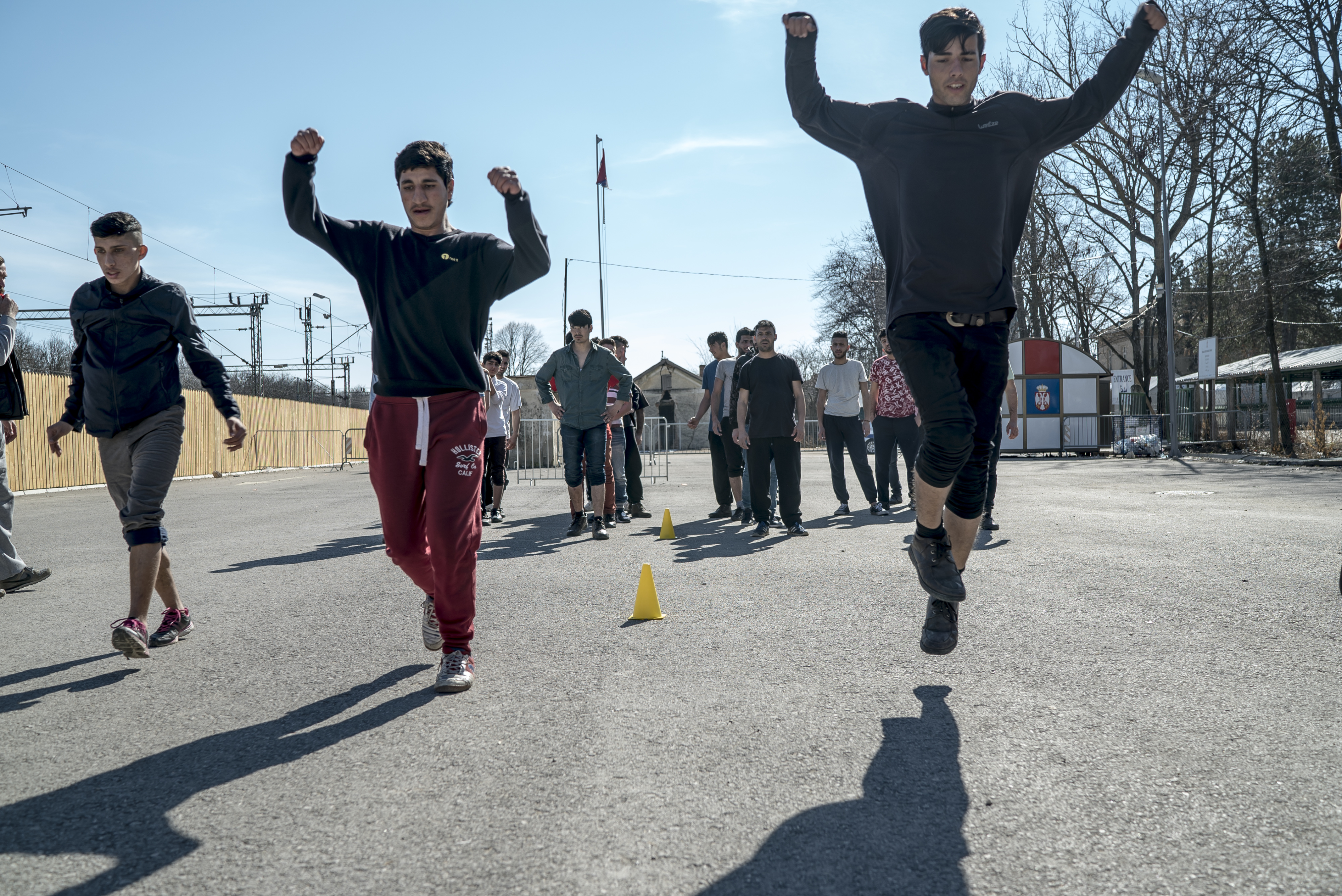 Boys exercising in a refugee camp in Serbia