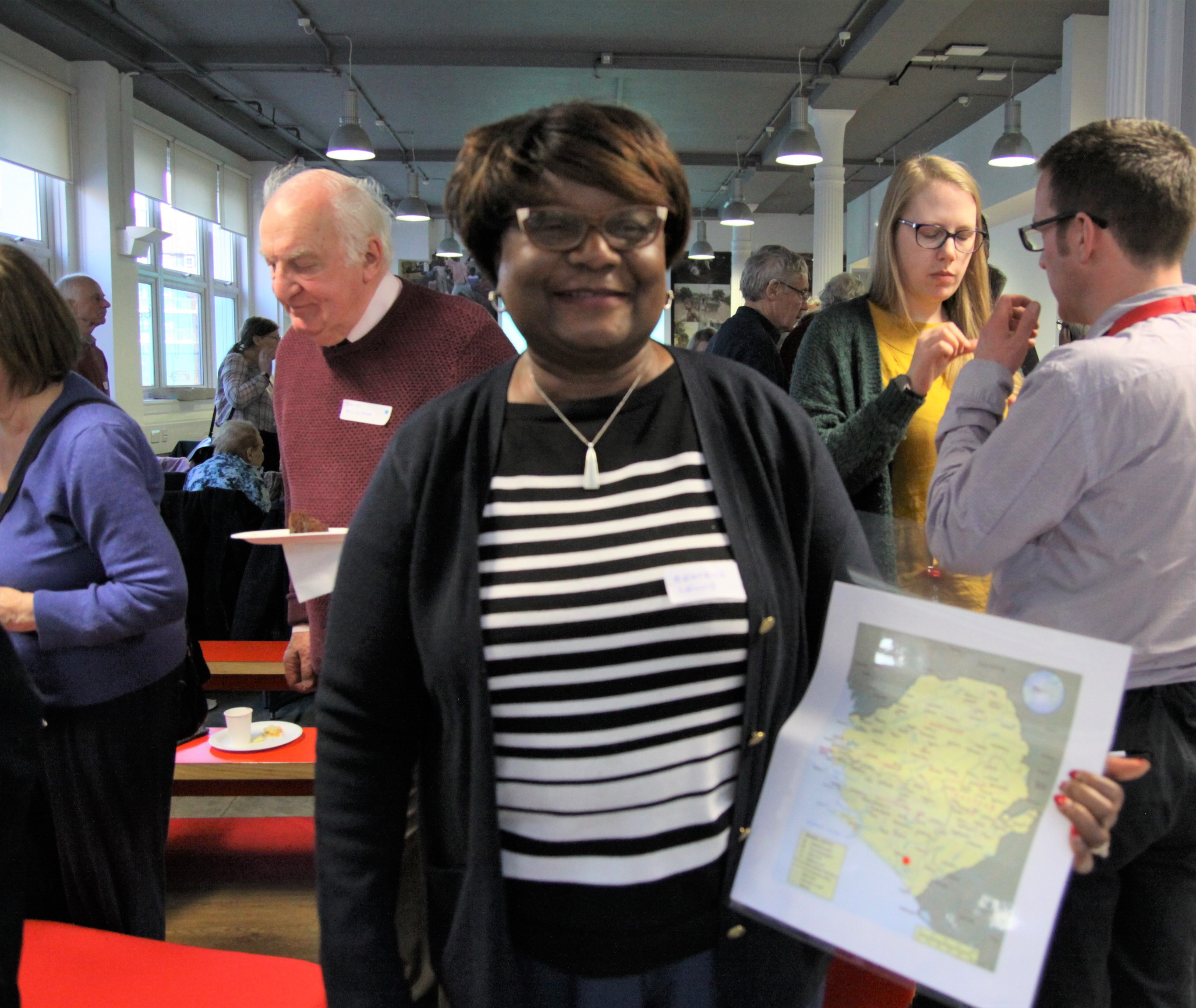 One of our Croydon Church Reps, originally from Sierra Leone, holds a map showing the location of Sawula village, the heart of our maternal healthcare in Sierra Leone theme