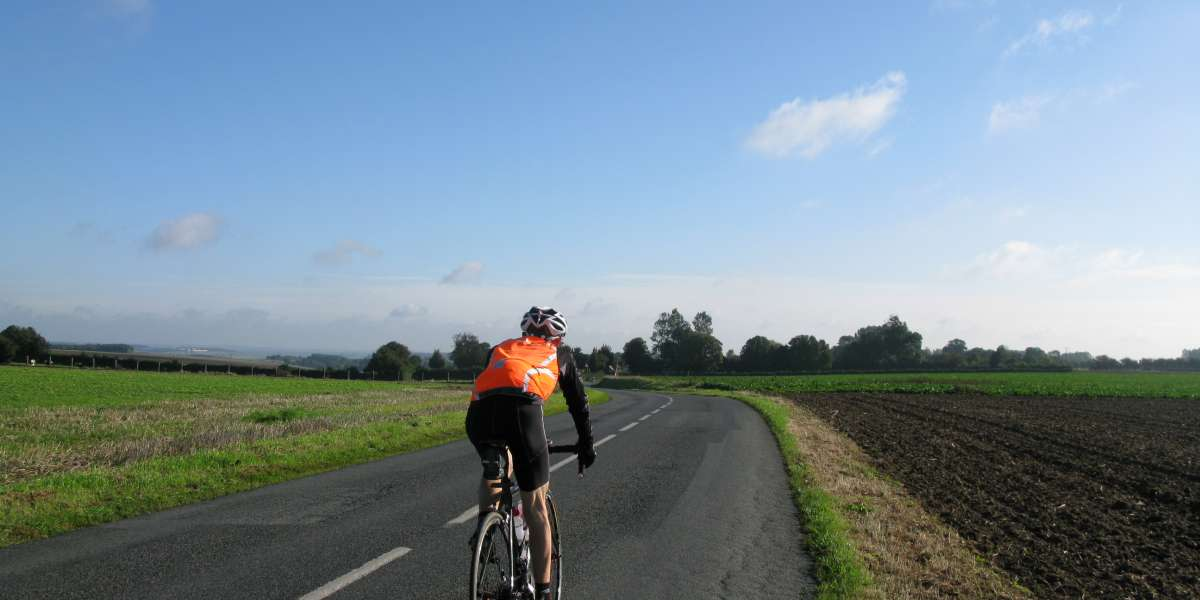 A Christian Aid fundraiser cycling through the countryside