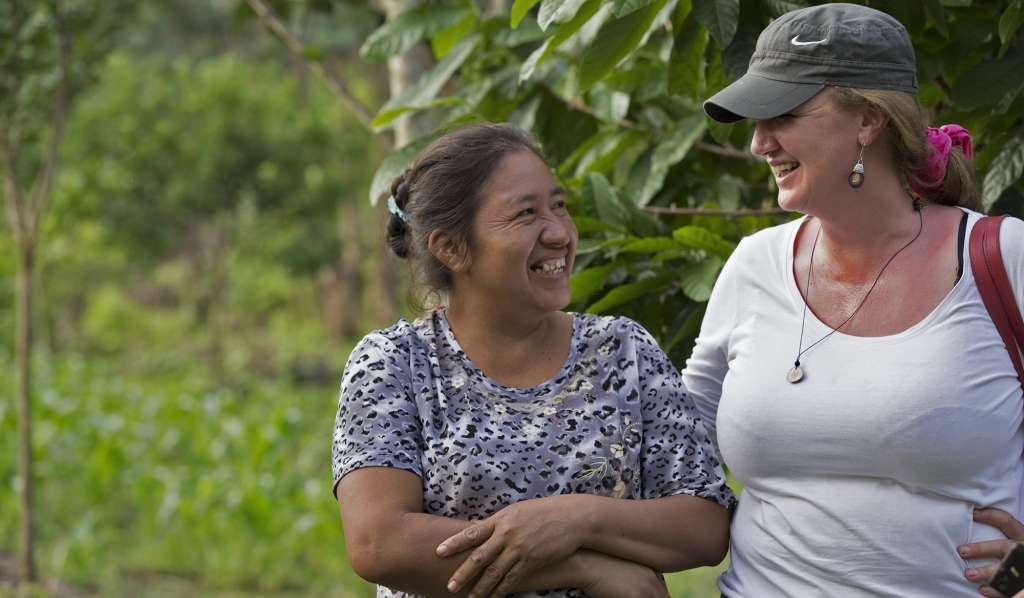 Emma Donlon speaks with local woman, Esther, in the Amazon rainforest