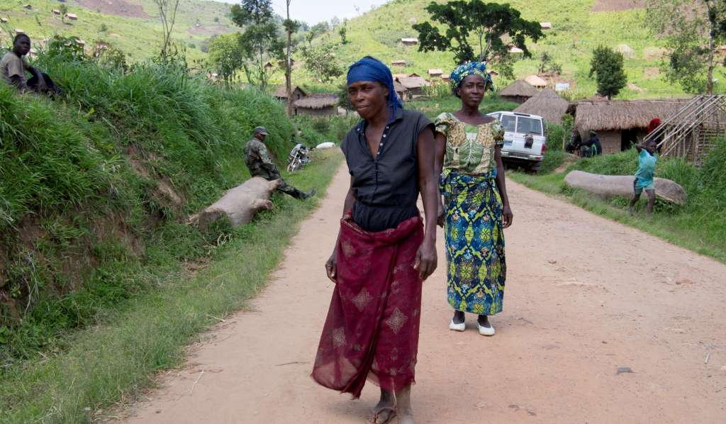 Two women along a road in a village in the Democratic Republic of Congo