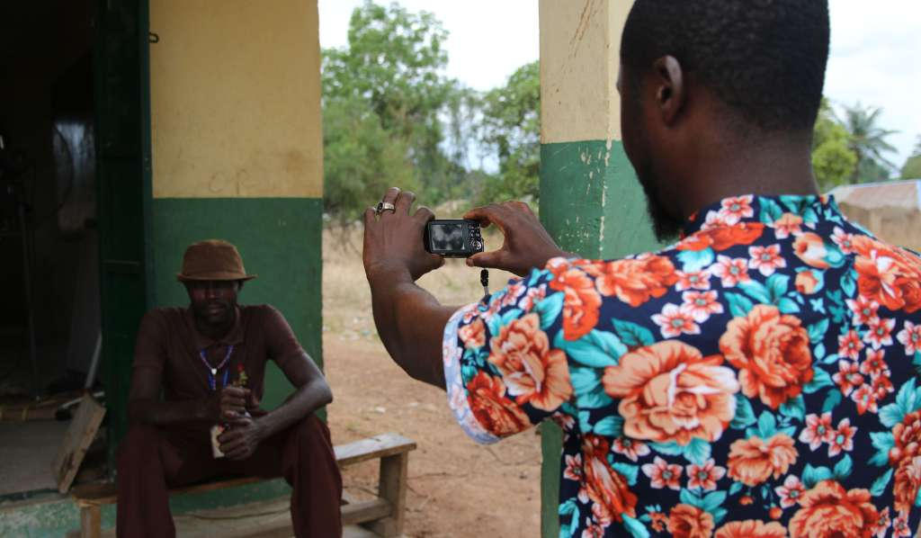 Gabriel Amali takes a photo during a participatory photography session in Nigeria