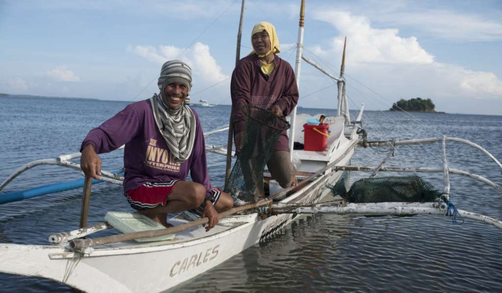 Lope and Eva in their fishing boat returning from fishing