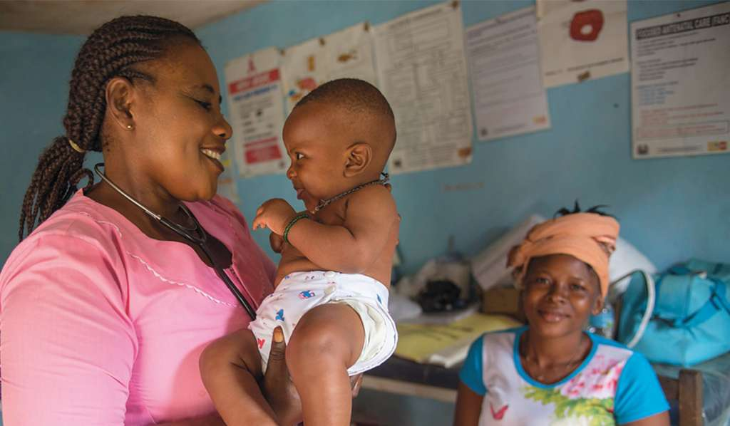 Nurse Judith serving mums and babies in her health clinic in Sierra Leone - Christian Aid
