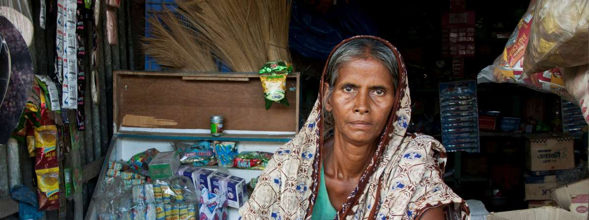Woman in a kiosk, Bangladesh