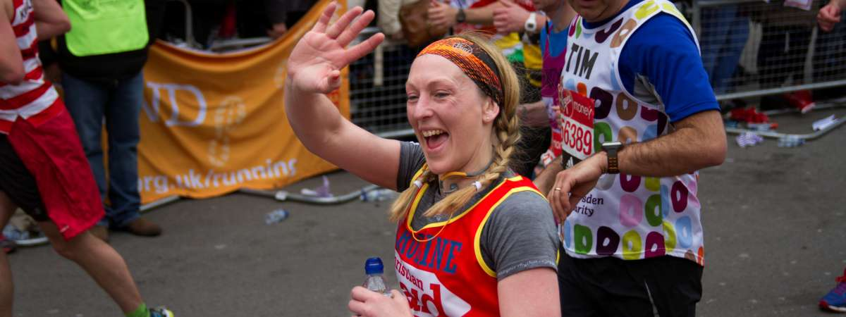 A woman takes part in a fundraising running event for Christian Aid