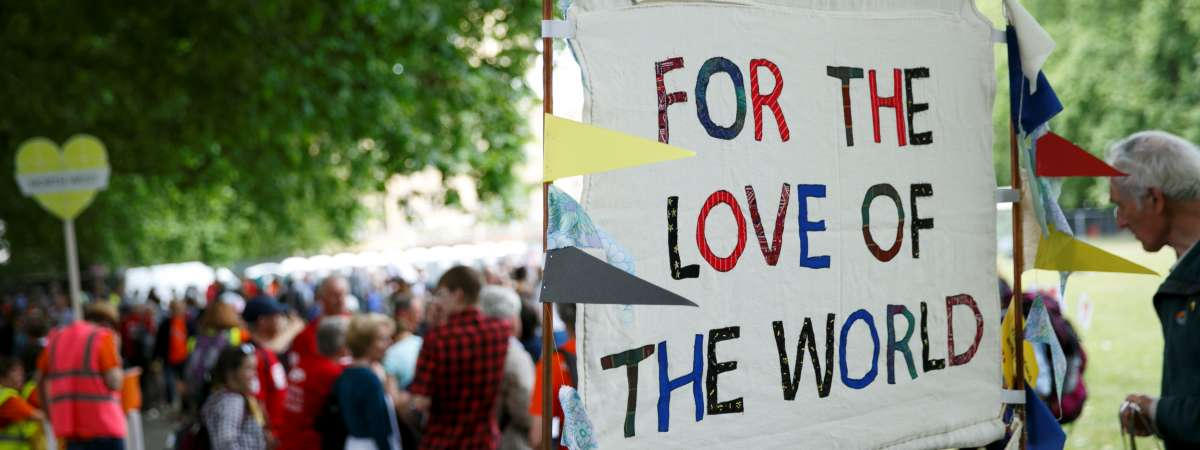 Campaigners hold up a sign that says 'For the love of the world'