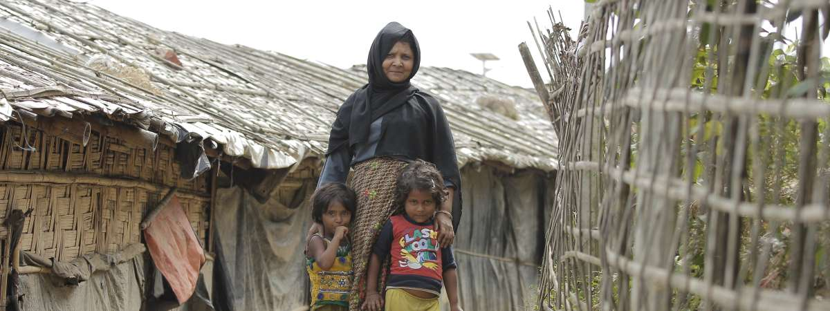 A mother and children inside the Rohingya camp run by Christian Aid