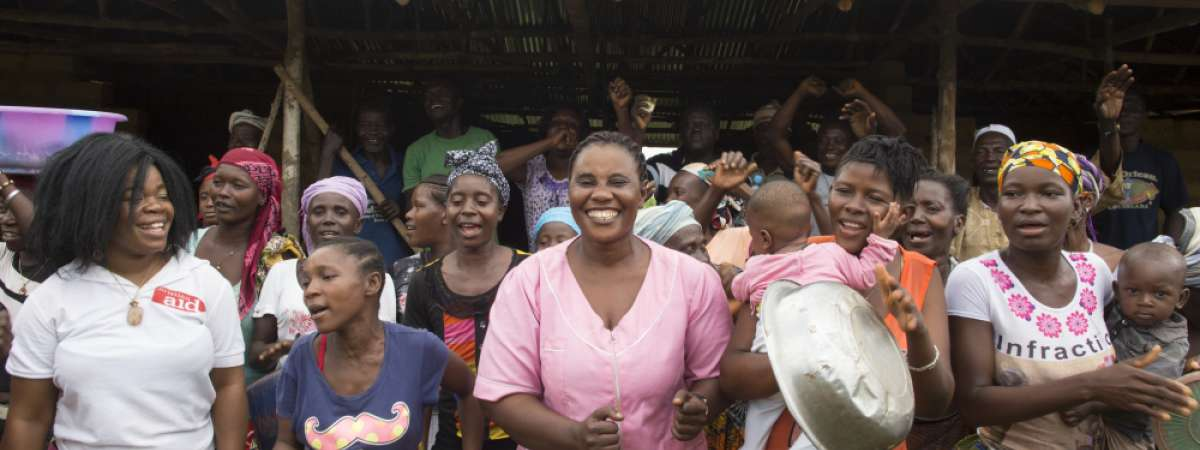 A community celebrating the building of their new health clinic