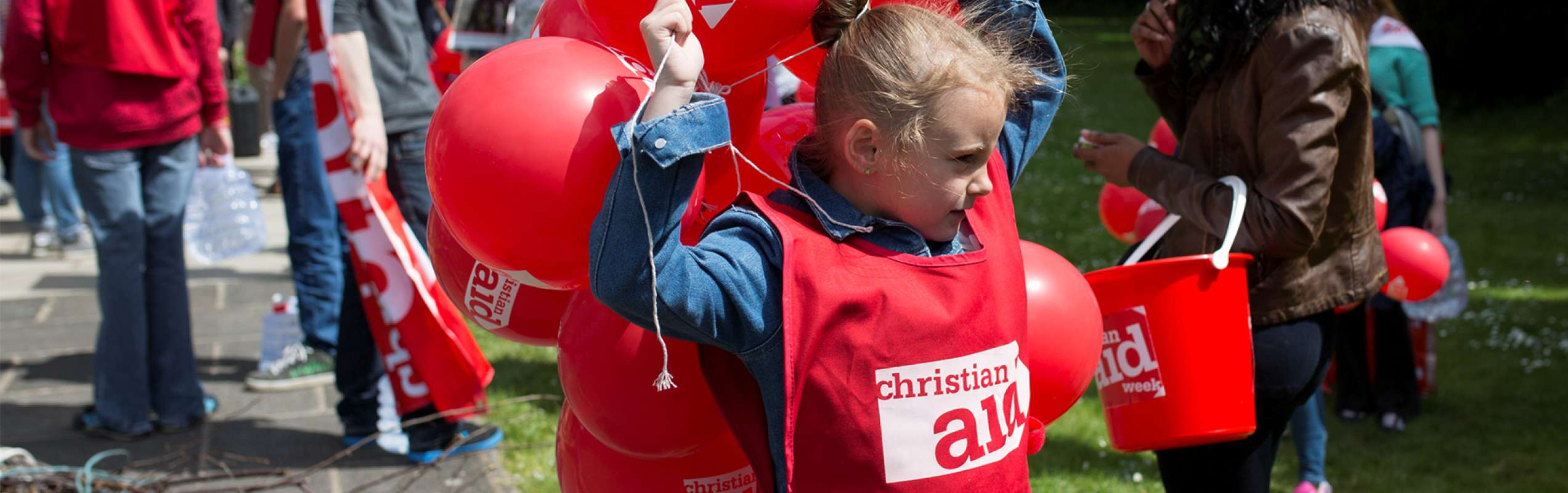 Child in Christian Aid tabard