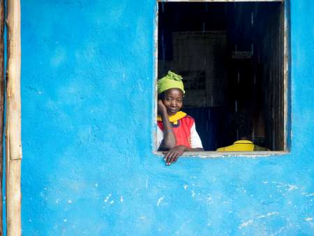 Woman looks out of a window in Bene Tsemay, Ethiopia