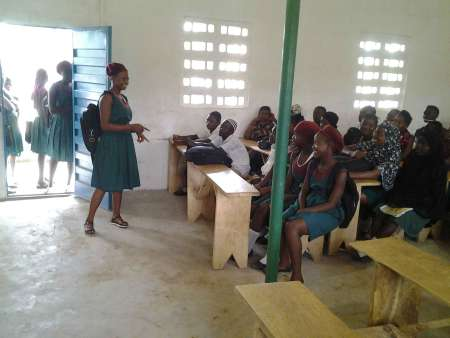 Mariama Barry sharing experiences at a school club in Kono District