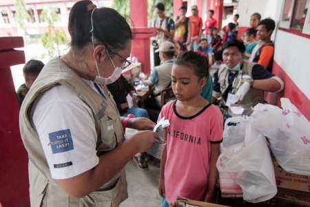 Ten-year-old earthquake survivor Ayu, who suffers from asthma, receives medicine from Christian Aid's partner Yakkum Emergency Unit