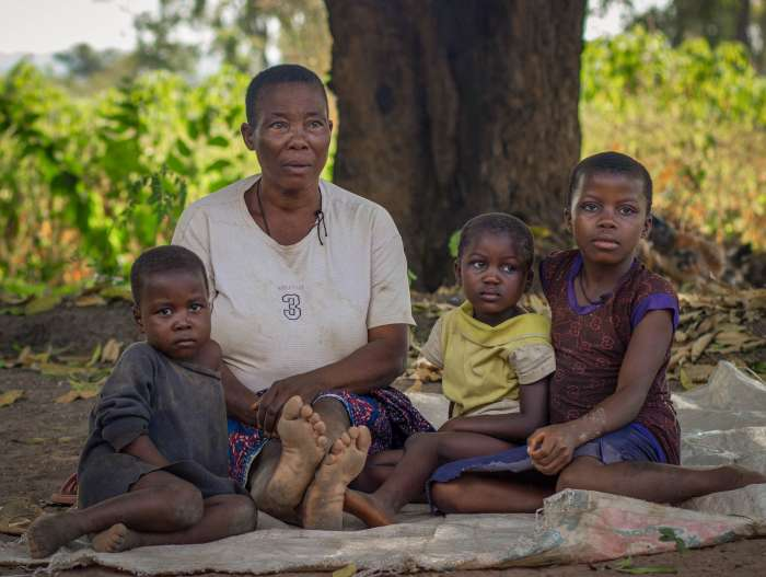 Elizabeth Lornenge with her three grandchildren outside their home in Usar community, Benue Stat, Nigeria.