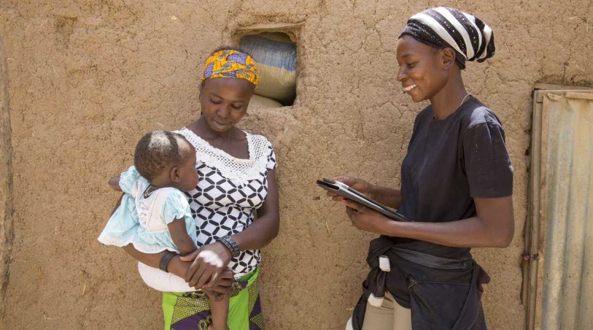 Sally Belem, 32, conducts a survey into child nutrition in the Yako area of Burkina Faso.