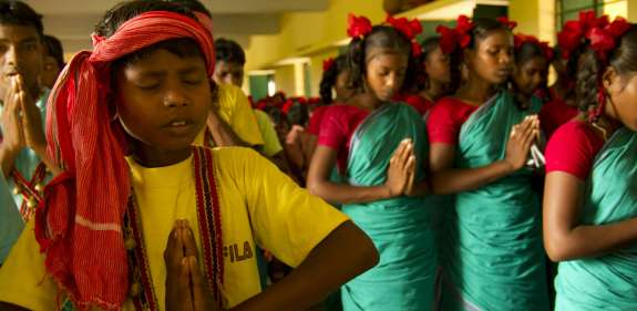 Children praying, India