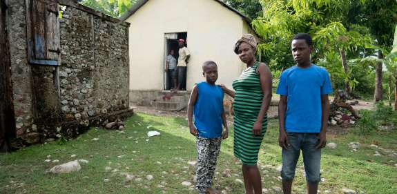 Vilia and sons outside house, Haiti