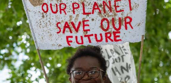 A young person protests against climate change in London.