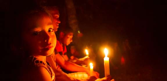 children holding candles in Colombia