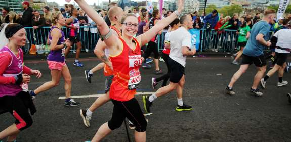 Christian Aid runner, Zoey Wickens, cheered on by supporters during the 2019 London Marathon