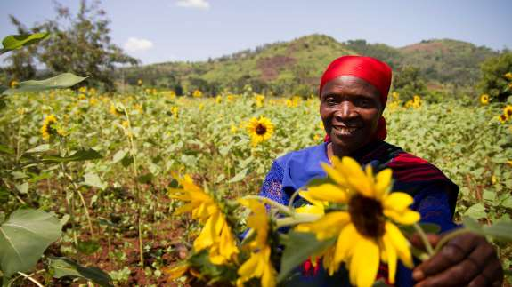 Burundi woman with sunflowers