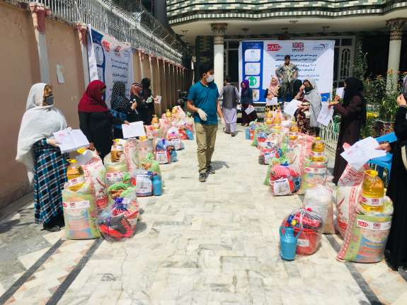 A4J supports a group of internally displaced women to receive food and hygiene packs in Kabul city.