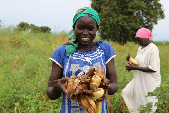 Rebecca Awan with a handful of freshly harvested crops