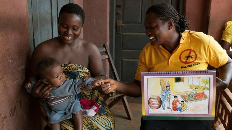 Mother and baby receive maternal health advice in Nigeria