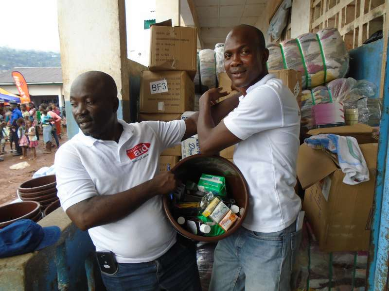 Two Christian Aid workers distributing donations in Freetown, Sierra Leone