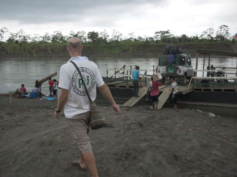 Volunteer Jack Grundy in front of lake in remote region of Colombia.