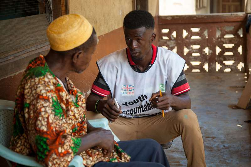 A youth accountability volunteer collects data during our SABI program, which aims to increase awareness of, and demand for, the delivery of basic services.