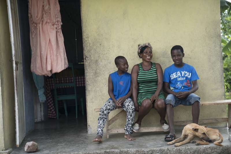 Vilia with sons in Haiti