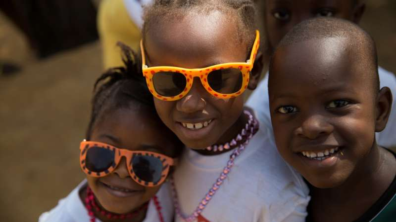 Children orphaned by the Ebola crisis smiling in Sierra Leone Christian Aid