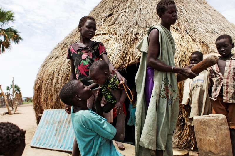Nyakuong with her children in South Sudan