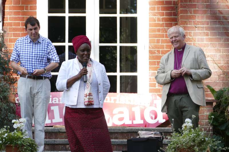 Amanda Mukwashi addresses CA supporters as John Glen MP and Bishop Nick listen