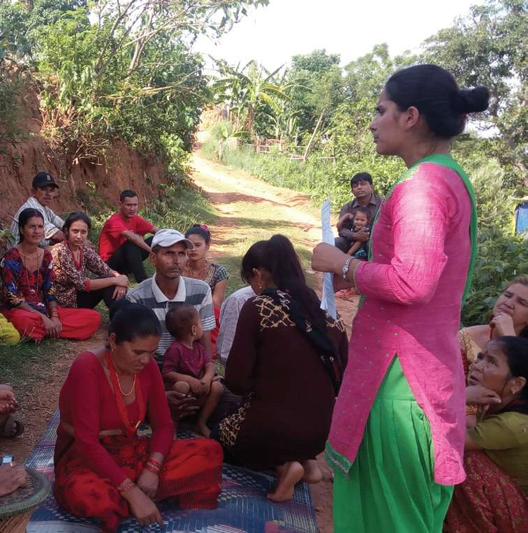 An enumerator facilites 'Community Level Participatory Reflection Meeting' during field level learning event