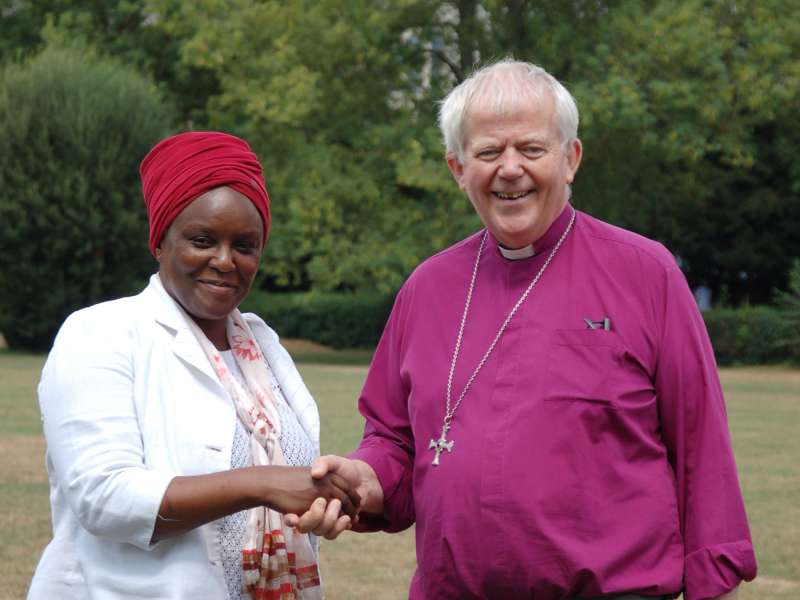 Our CEO Amanda Mukwashi shakes hands with Bishop Nick outside Salisbury Cathedral