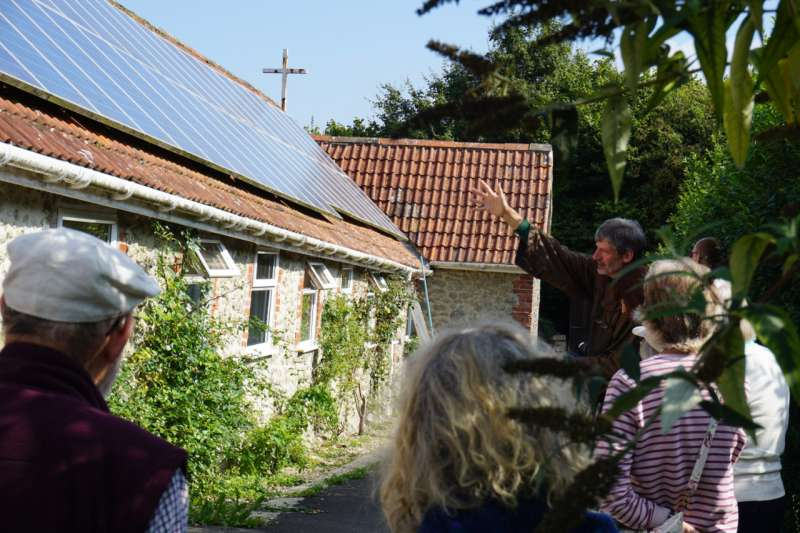 Brother Hugh points to the solar panels on the chapel's roof